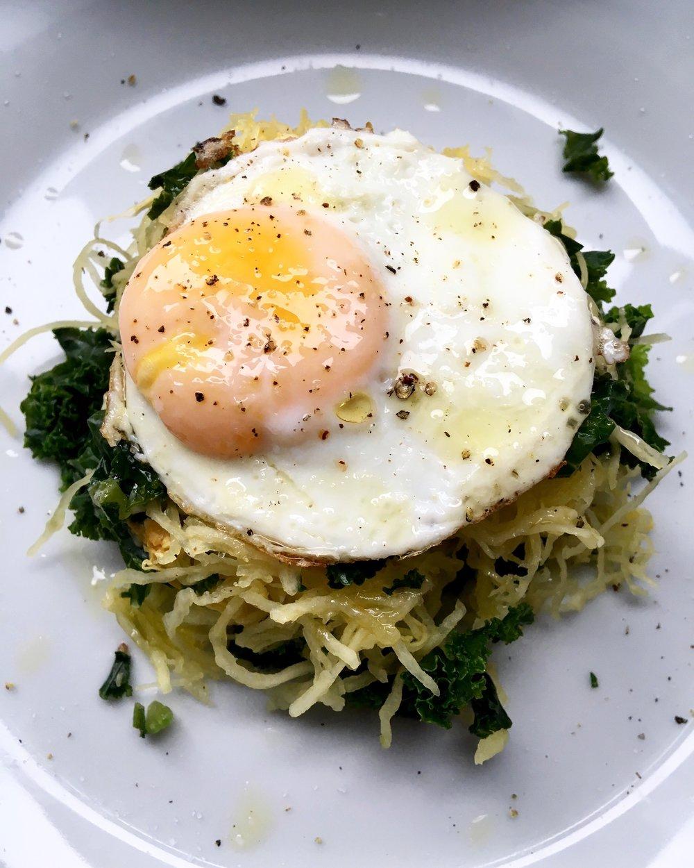 roasted spaghetti squash + kale nest with sunny side up egg