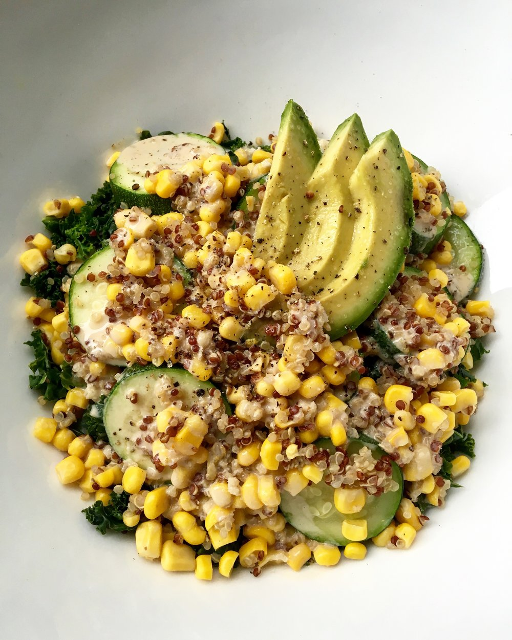 quinoa, corn, zucchini, kale + avocado salad