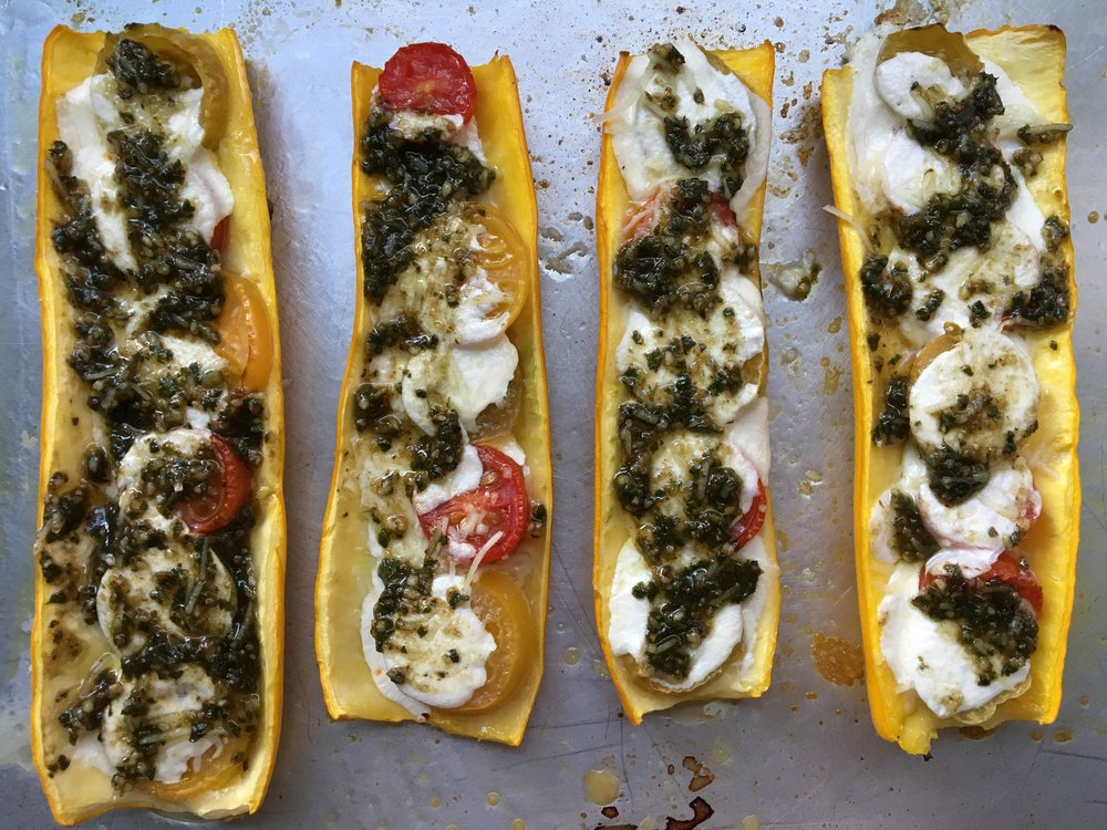 zucchini boats with mini heirlooms, fresh mozzarella + pesto