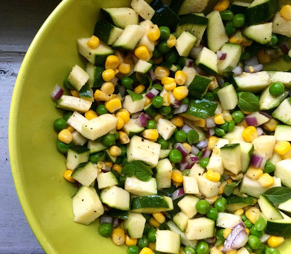 zucchini, corn, pea + red onion salad with fresh oregano