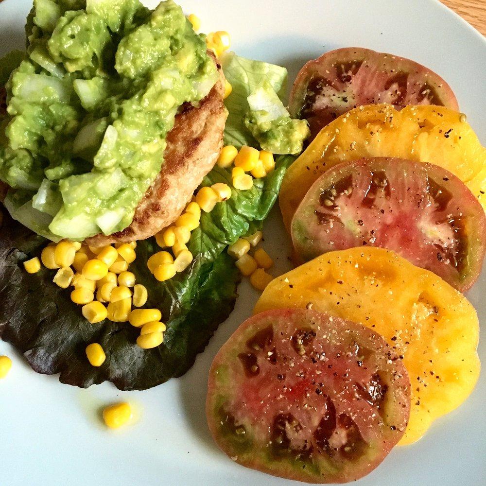 Farm Fresh: turkey burger bathed in guacamole + side of heirlooms
