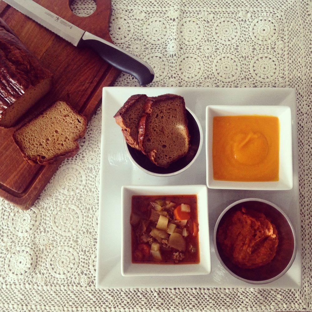 clockwise: Cashew bread, carrot soup, roasted red pepper + eggplant dip, hamburger soup