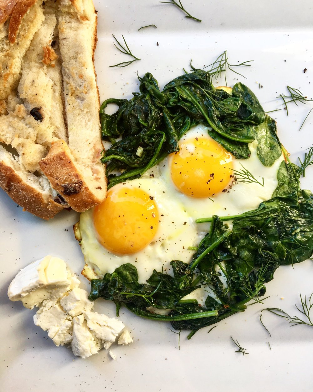 Herbed Spinach / Olive toast / Goat Cheese / Sunnyside Egg