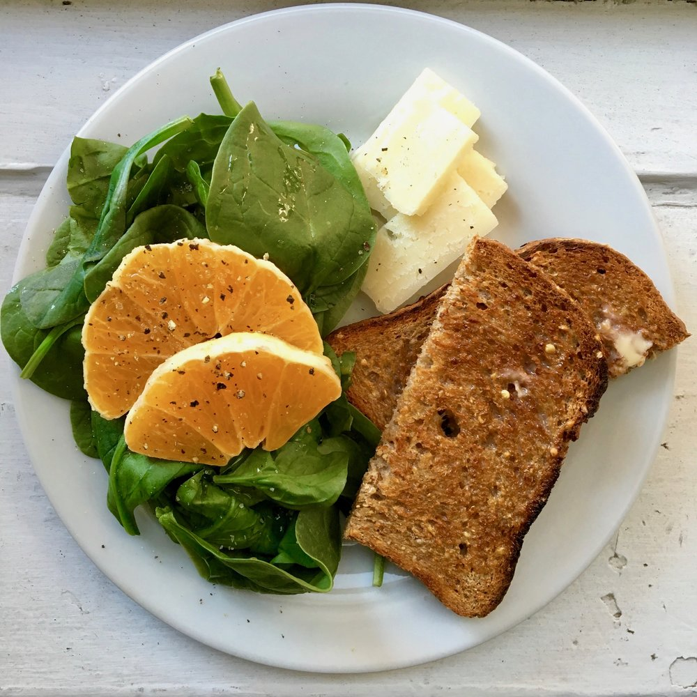 Ezekiel Sprouted Grain Toast with Butter, Spinach + Orange with Olive Oil and Pecorino