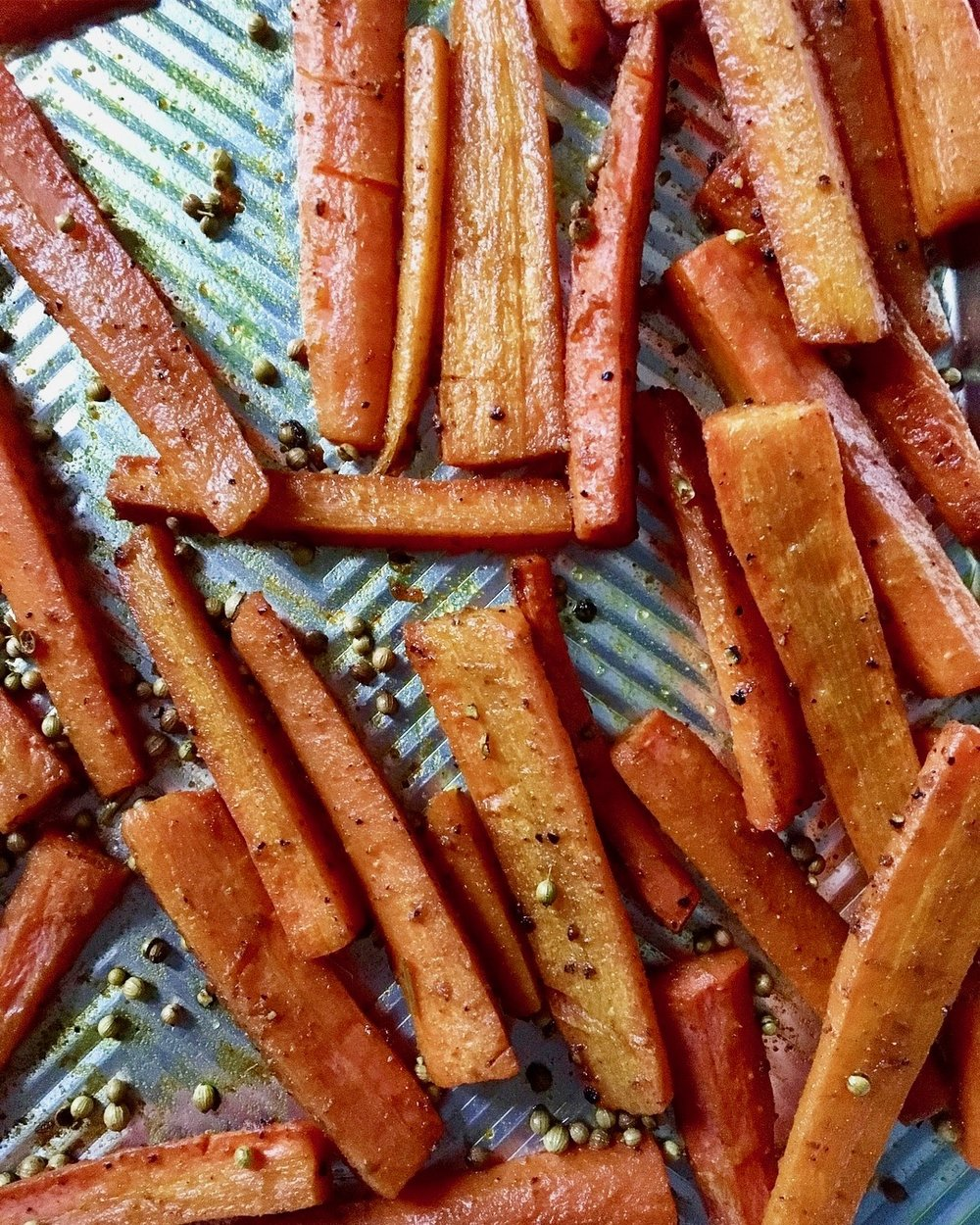 Coat your carrots in olive oil, whole coriander seeds, ground cumin, turmeric, smoked paprika and black pepper and roast until super soft, caramelized and deep brown. Notice we DO NOT salt prior to our roast as the veggies then release water and, I find, do not brown to their maximum potential.