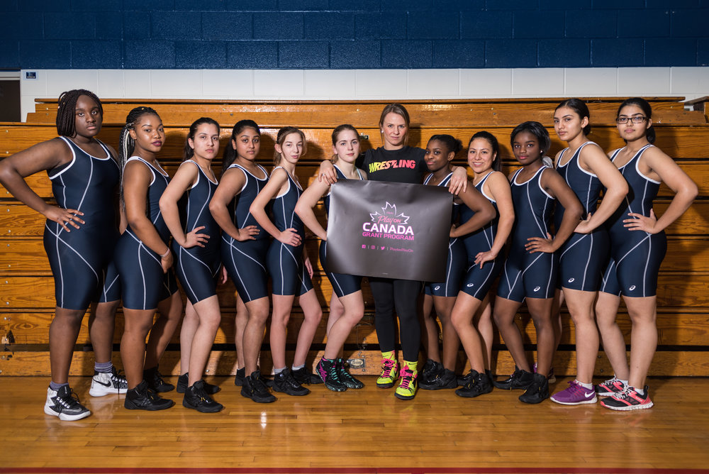 Erica Wiebe and the West Humber CI Girls Wrestling team.jpg