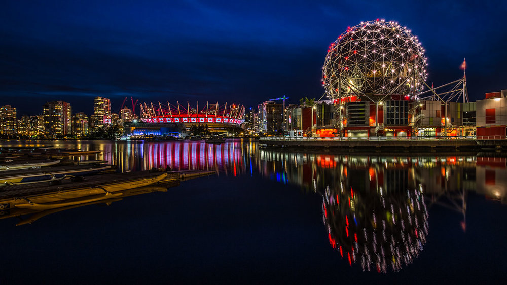 Glowing Cityscape: False Creek in Vancouver, British Columbia.