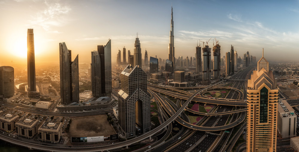 Morning Hours in Dubai: The Sunrise behind Downtown with the famous Burj Khalifa