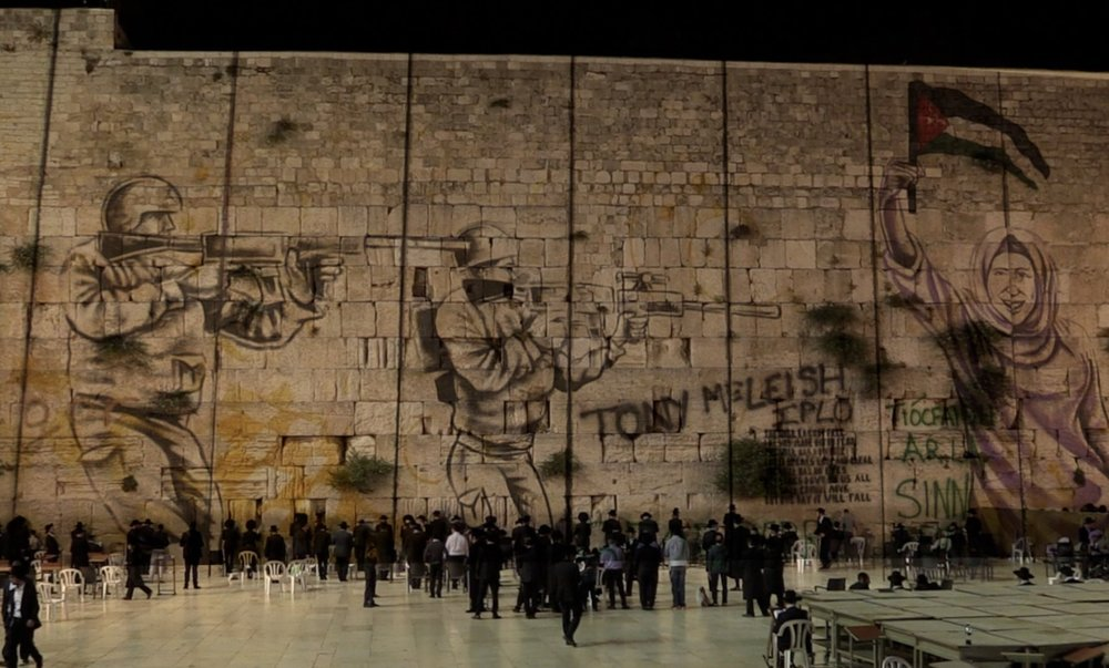 Graffiti from Israeli/Palestinian Security Wall superimposed on Jerusalem Western Wall