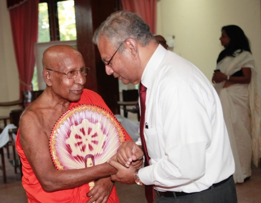 OMNIA President Premawardhana with Leader of Buddhist Delegation to OMNIA's Opening Reception in Kandy.