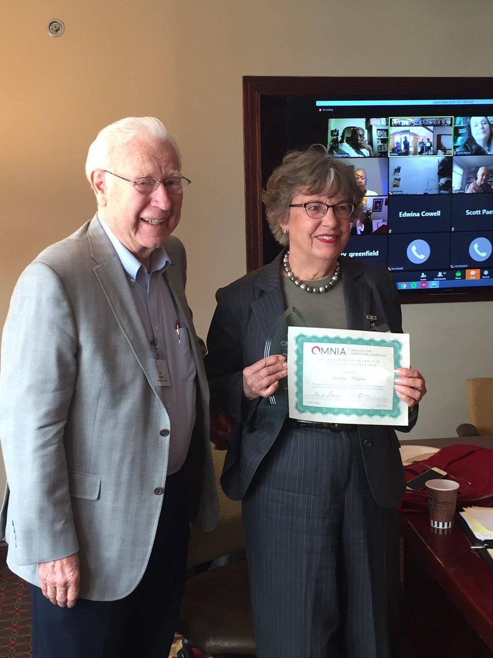 Rev. Dr. Ken Bensen presents OMNIAS's Leadership award to Suzanne Morgan