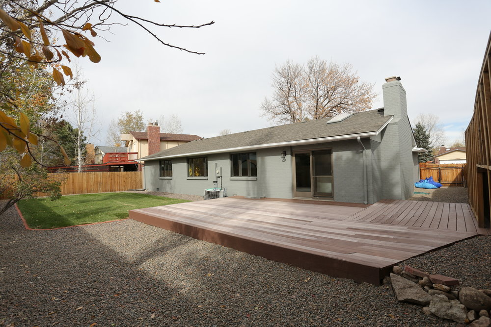 composite deck, great for an outdoor bbq or lounge space, rv storage, and new sod in yard