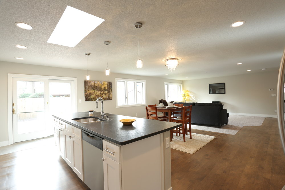 leathered granite counters, stainless appliances, tons of cabinetry and skylight over island