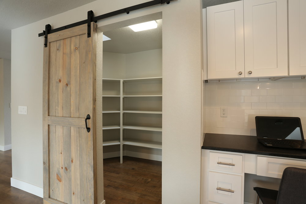 large walk-in pantry with tons of storage space and skylight - desk space in kitchen