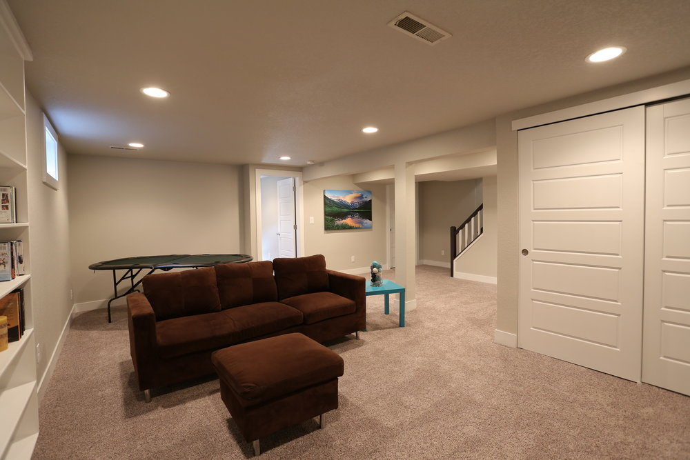 large basement bedroom (or home gym) located just off the media room
