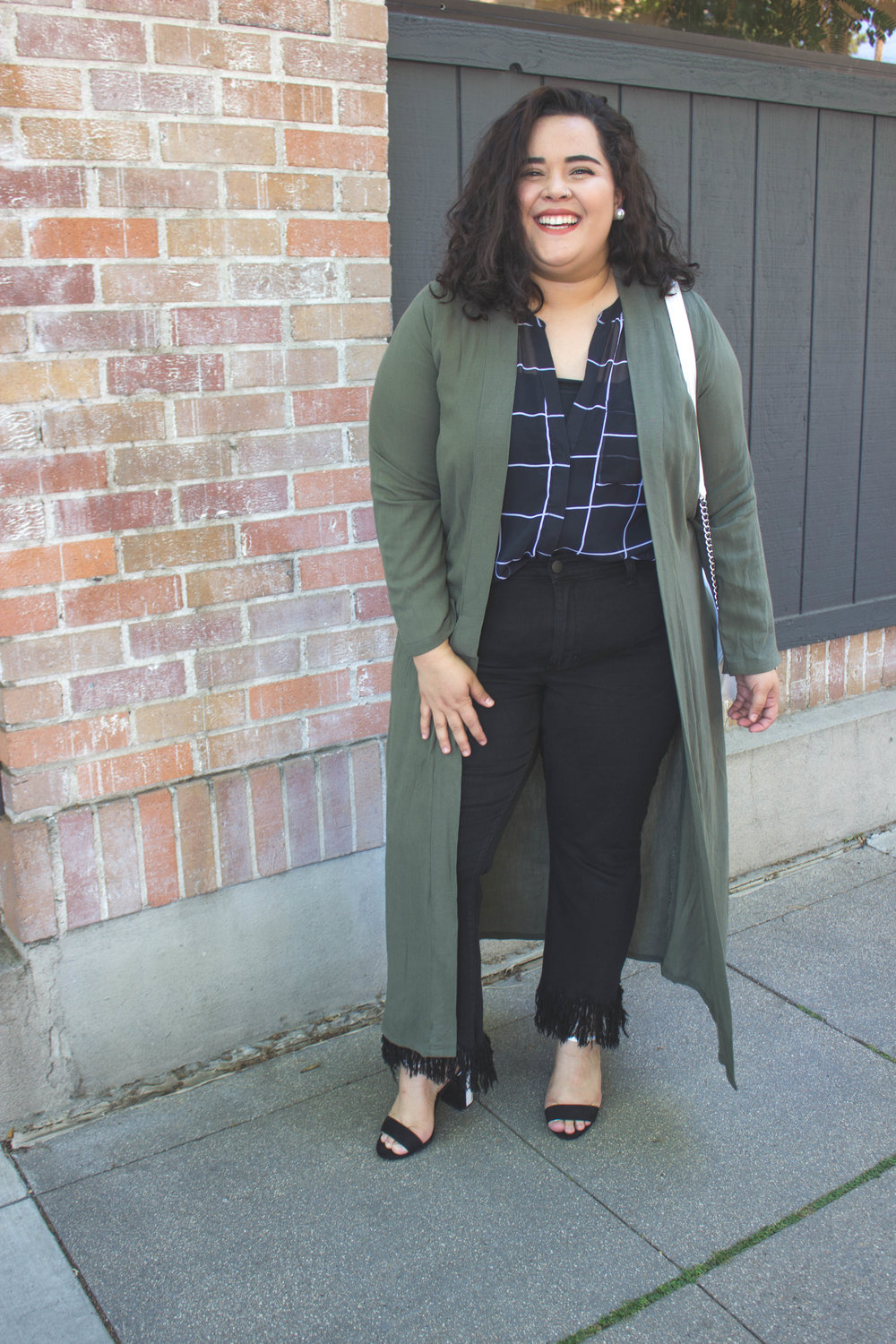 An Olive Green Duster   + Perfect contrast color for a black and white look   + White crossbody purse -