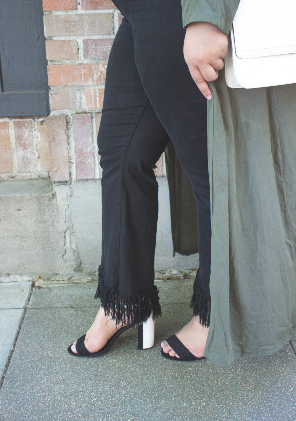 + Frayed black denim   + Black and white sandal heels   *Solid black or solid white heels work perfectly, too* -