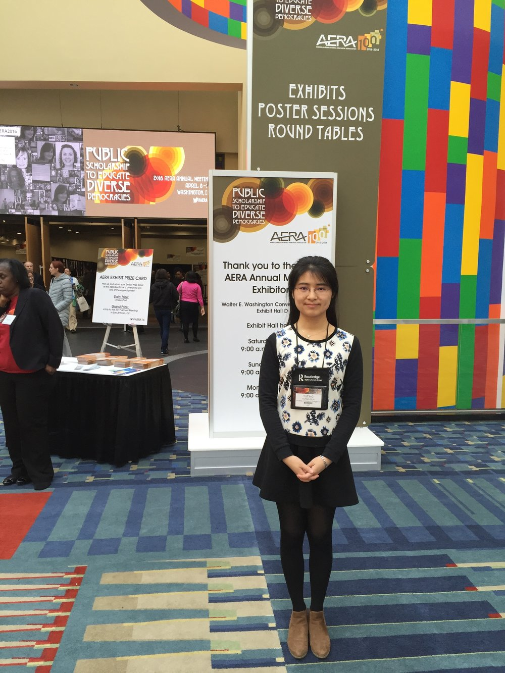 Yuting looking proud at her first American Education Research Association conference in Washington, D.C., 2016.