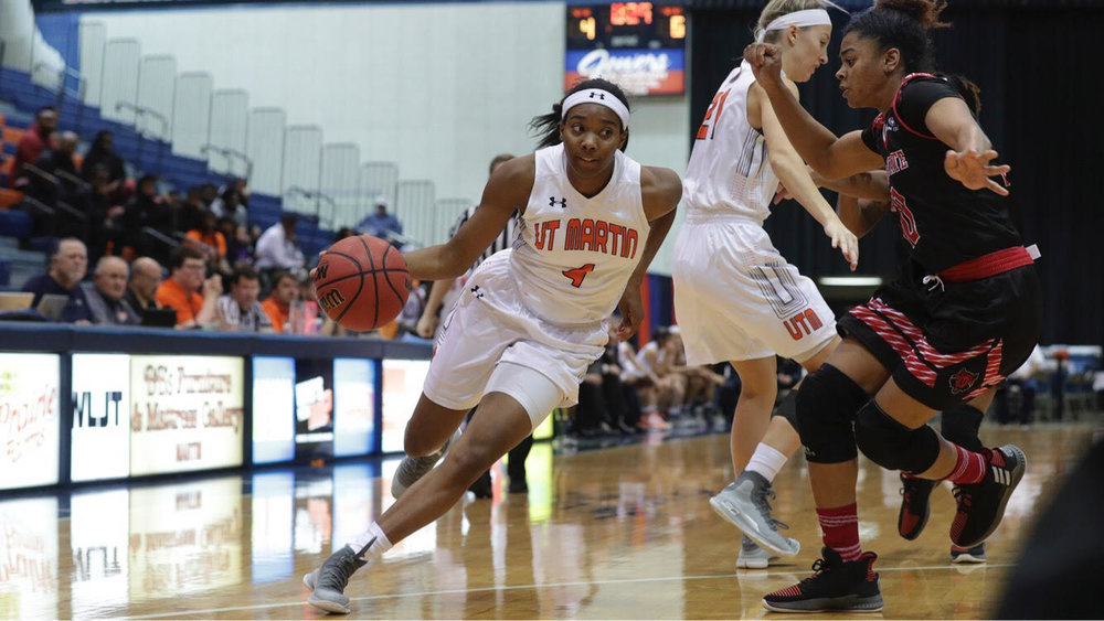 Senior Emanye Robertson drives against an Arkansas State defender