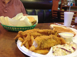 Fried Catfish, coleslaw, and a chili cheeseburger peaking out from behind the paper. And fries.