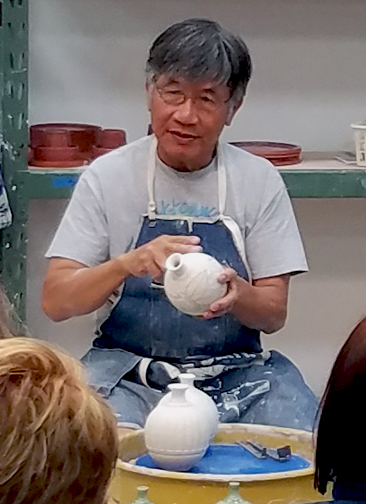 Chin talks about carving techniques while doing a demonstration.