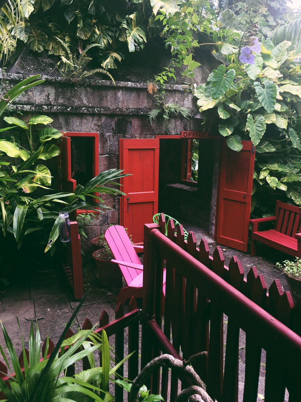Bold colors and lush green foliage await you upon arrival at Golden Rock Inn