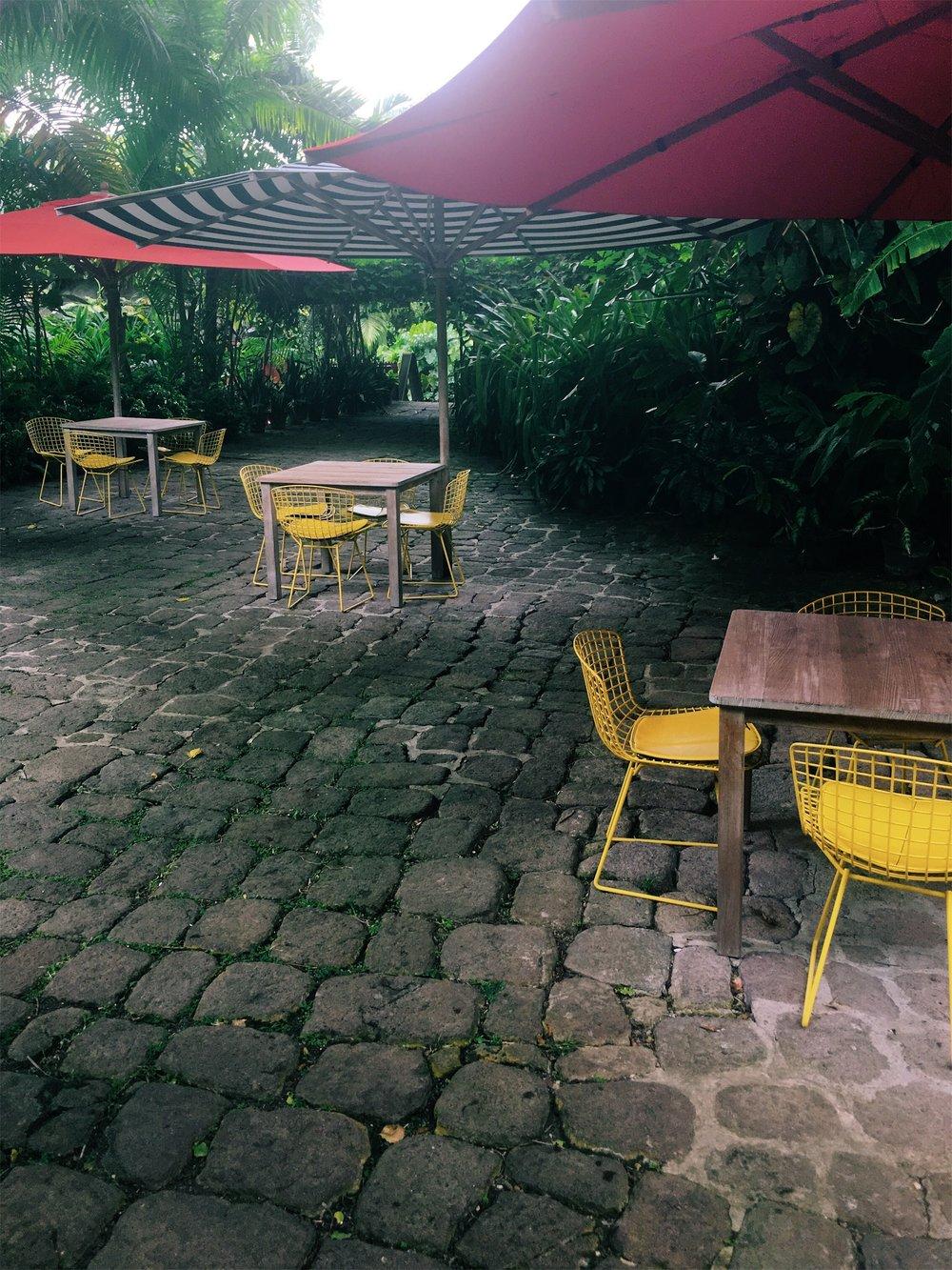 Colorful Bertoia chairs at Golden Rock Inn.