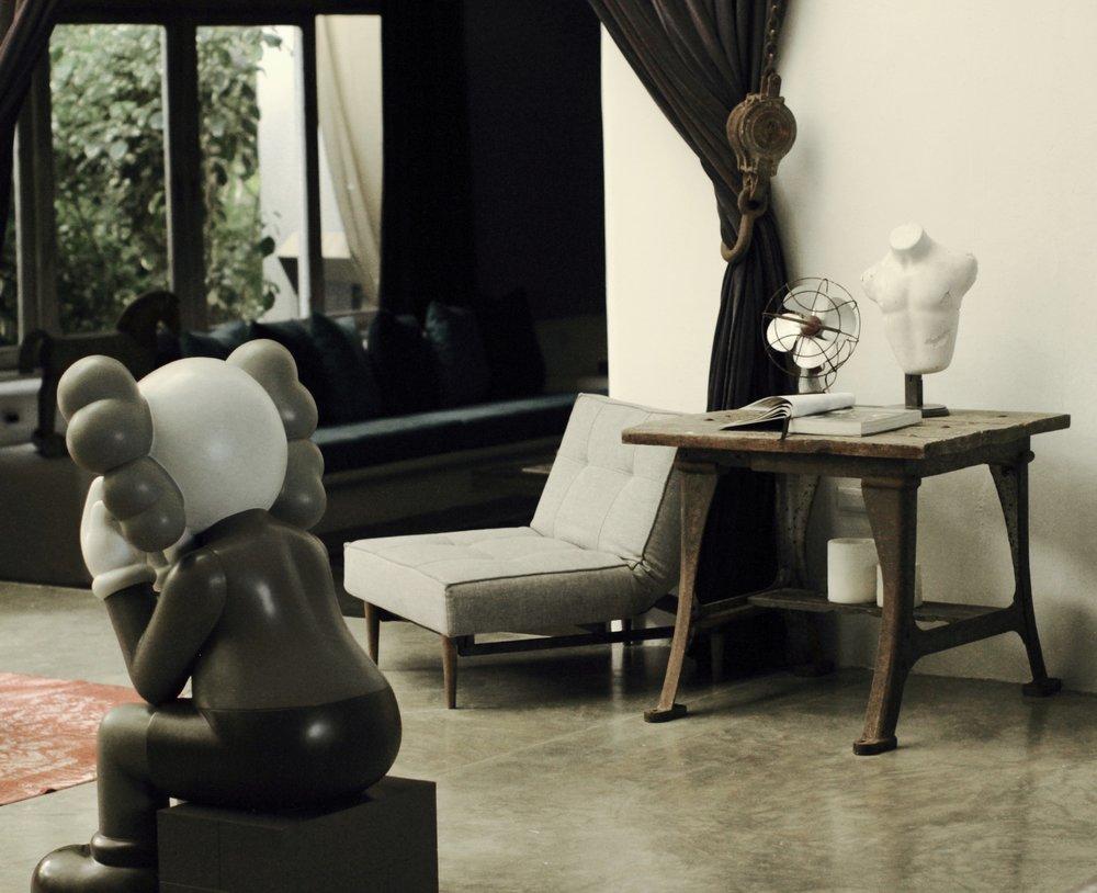 KAWS in living room/reception at Casa Malca