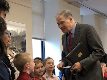Governor Jay Inslee talks with students from Eatonville SD about their composting project...