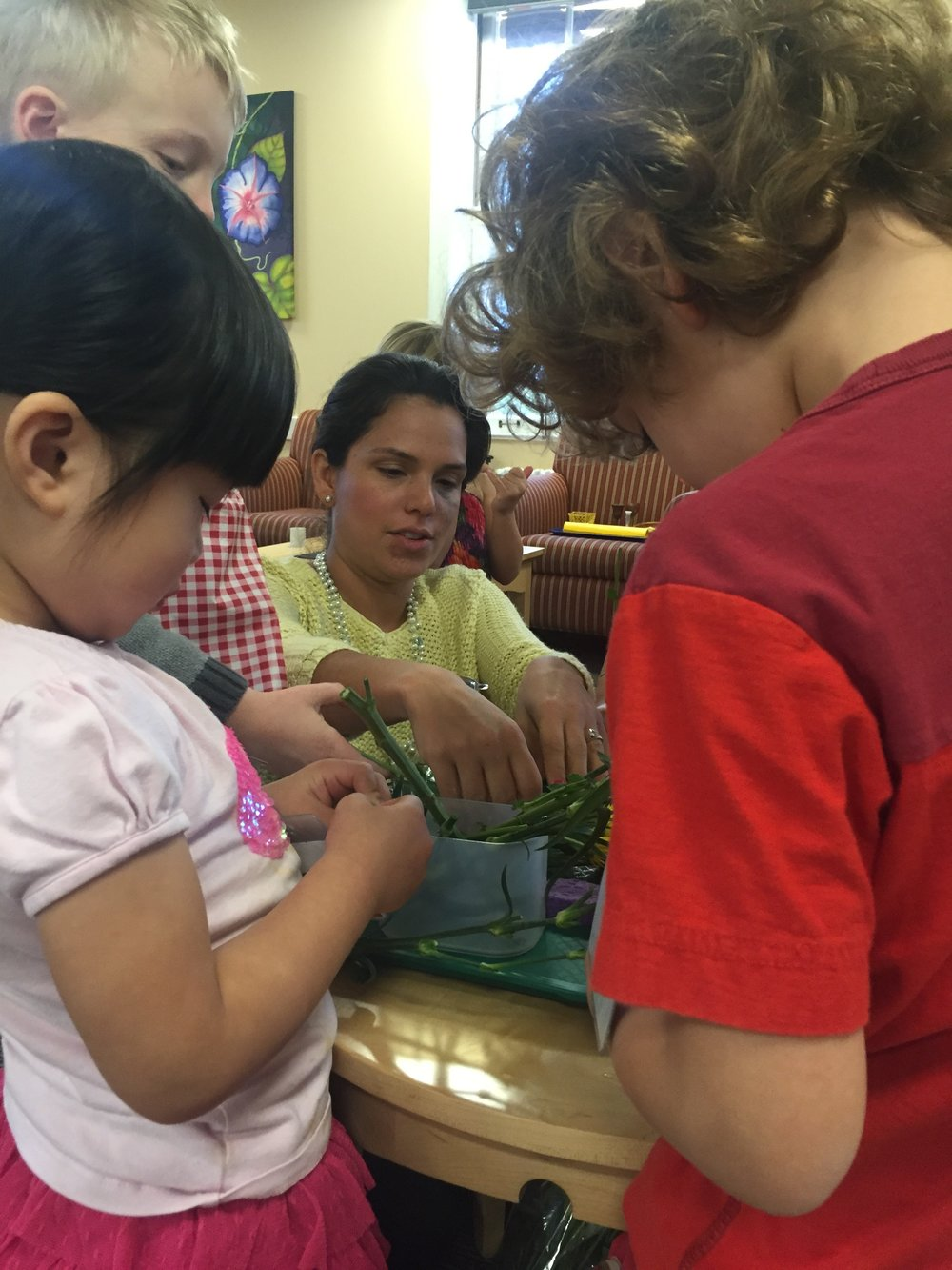 Catechist Emma, assists Level I children with learning through the CGS hands­on works, about the Mass parts, bible stories and their relationship with Jesus.