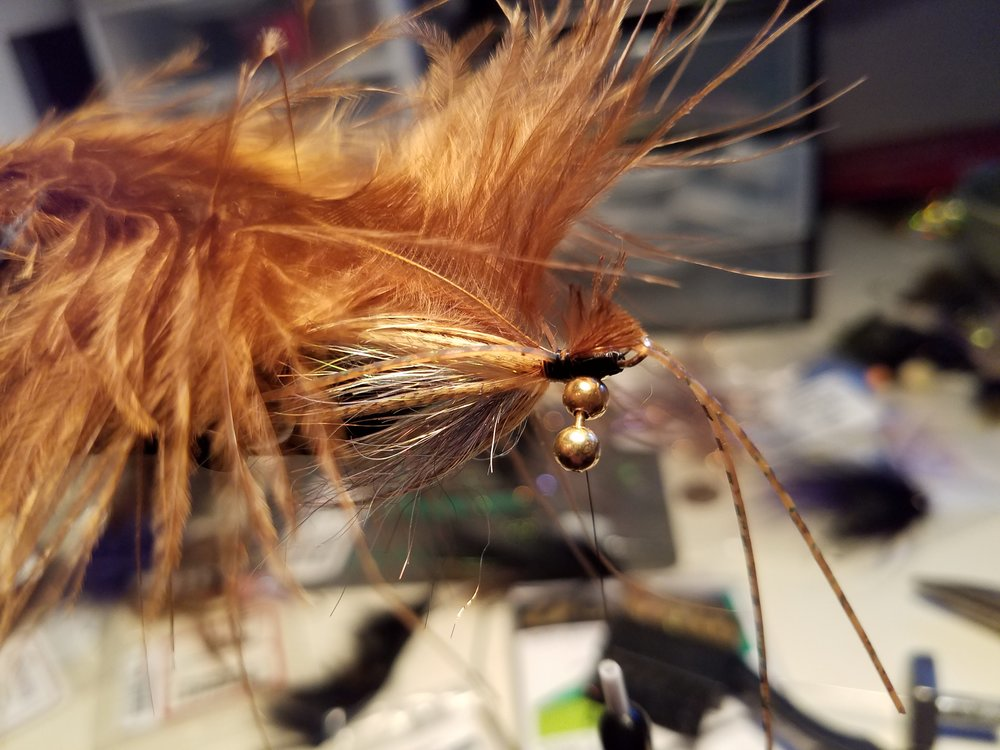 A BASE OF BLENDED ICE DUB WITH AN OVERLAY OF MALLARD FLANK AND BROWN MARABOU.  RUBBER LEGS TRAILING BEHIND.