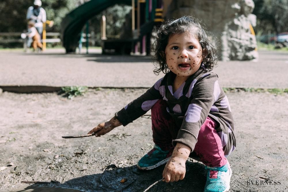 Little girl mud splatter face