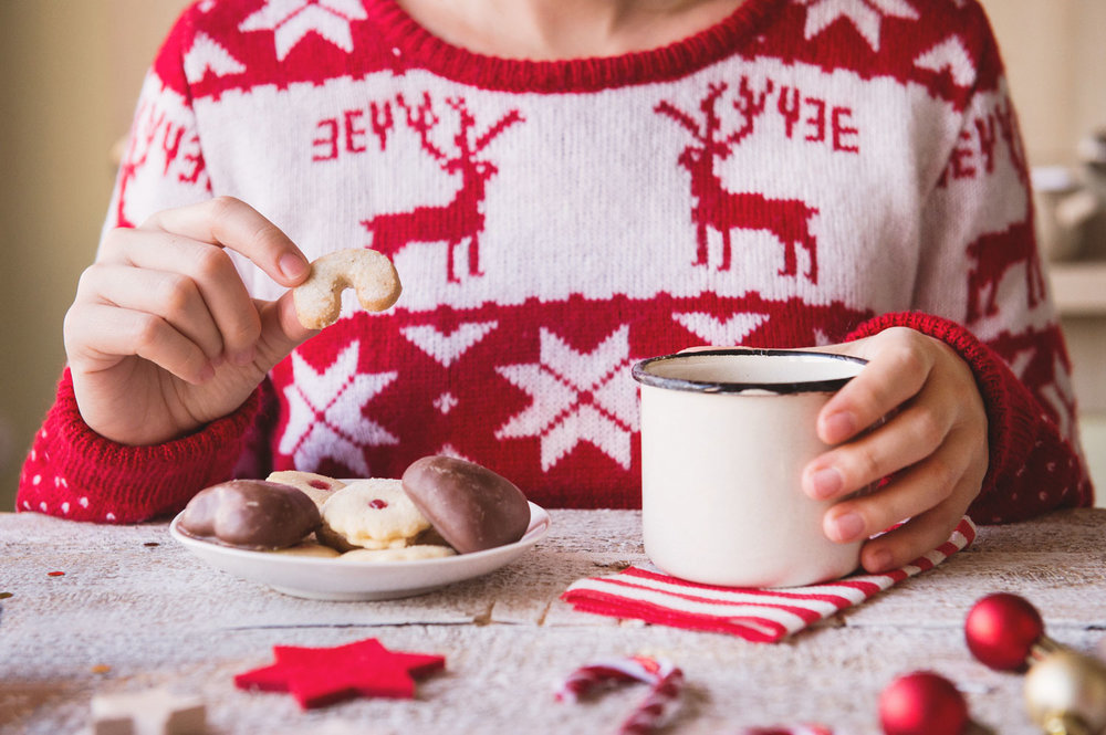 christmas-woman-eating-cookies.jpg