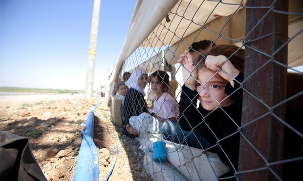 A Syrian family finds shelter at a refugee camp on the Turkish-Syrian border. Photograph: Dona B/Pacific/Barcroft Images