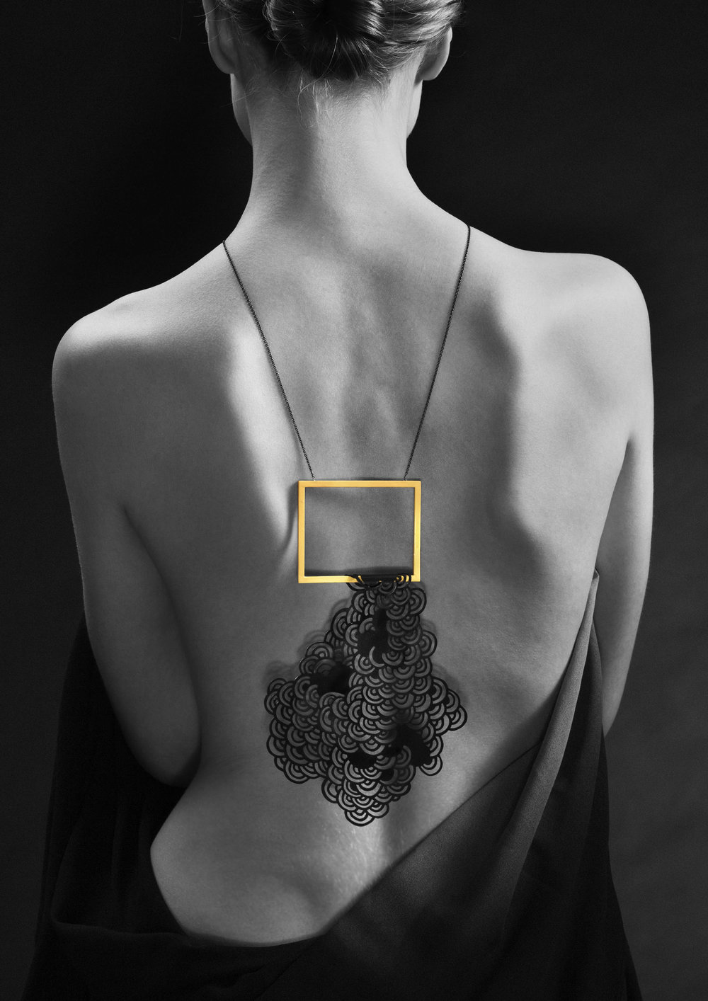The Black Cloud. 2013  Pendant. Oxidized copper, laquered brass and xidized silver. Photo by Jan Alsaker.