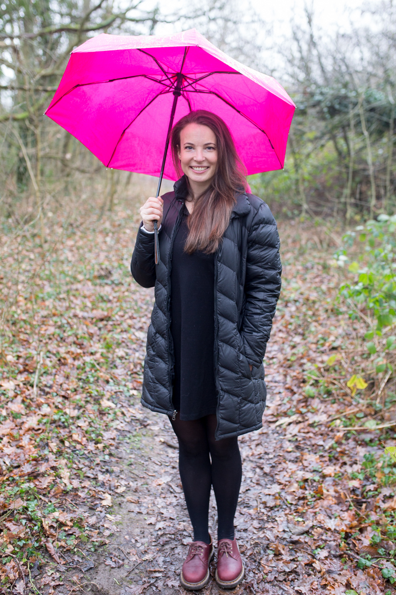 Tara with one of her favourite products: a pink umbrella, available on Buy Me Once. Photographed by Marc Bates