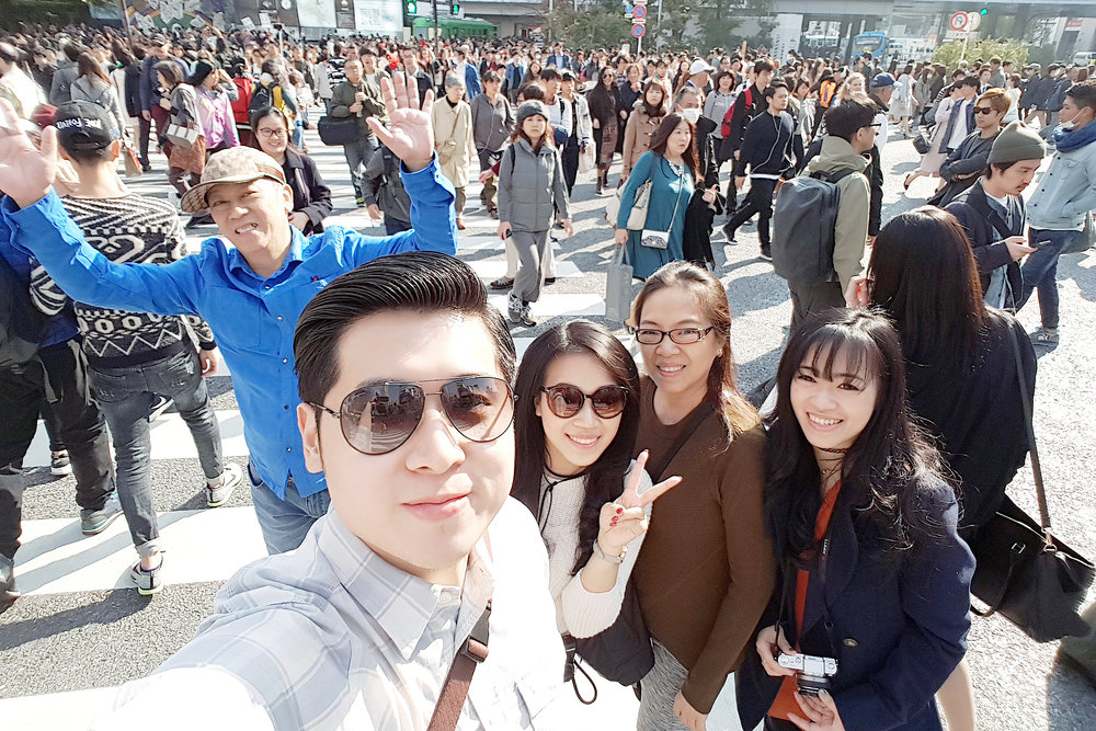 Wefie in the midst of pedestrians.