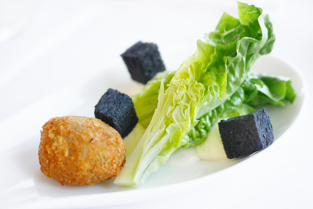 Caesar Salad ,   Parmesan Mousse, Chicken Crocket, Black Garlic Croutons