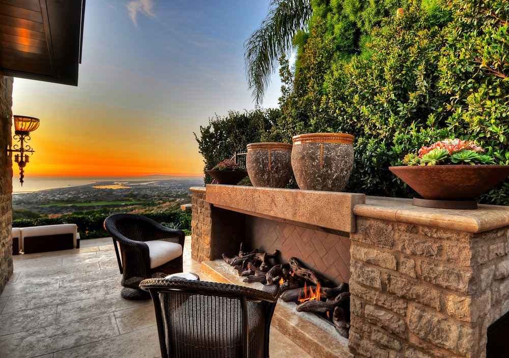 custom outdoor fireplace by newport harbor in California