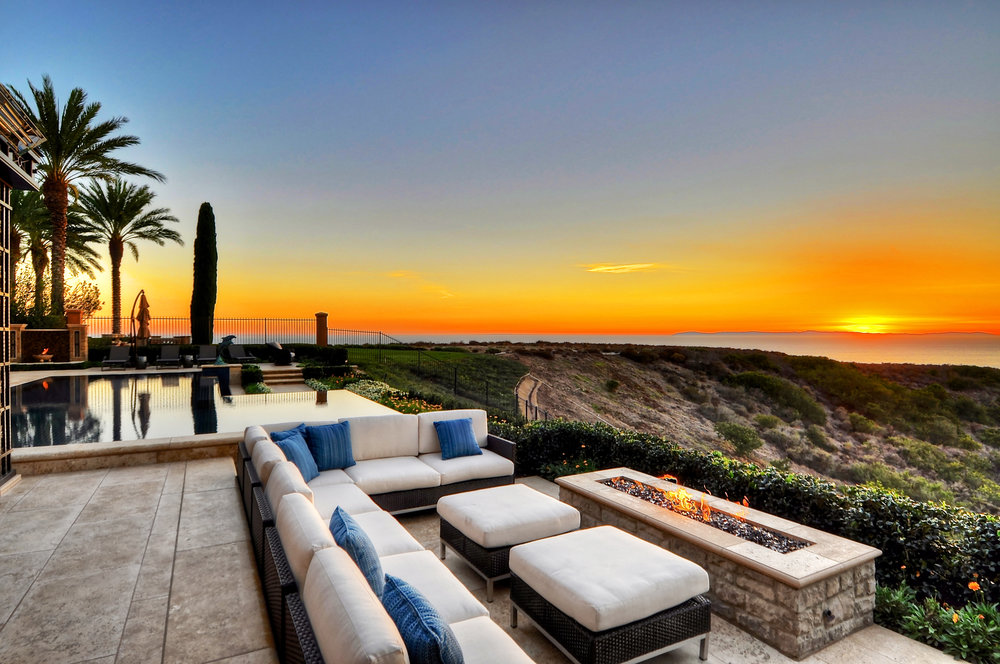 Newport Harbor home with custom swimming pool and fireplace