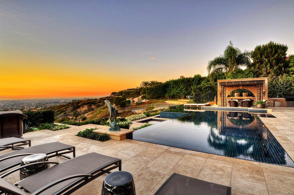 swimming pool and patio at Newport Harbor, California home