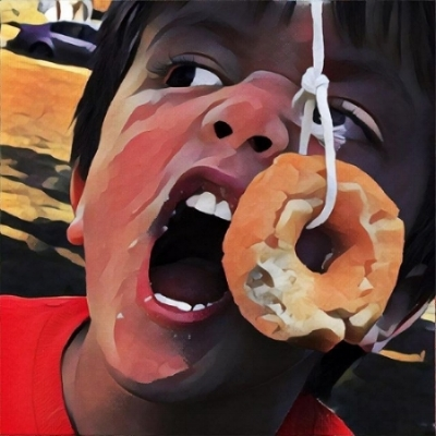 My oldest son competing in a donut eating contest.