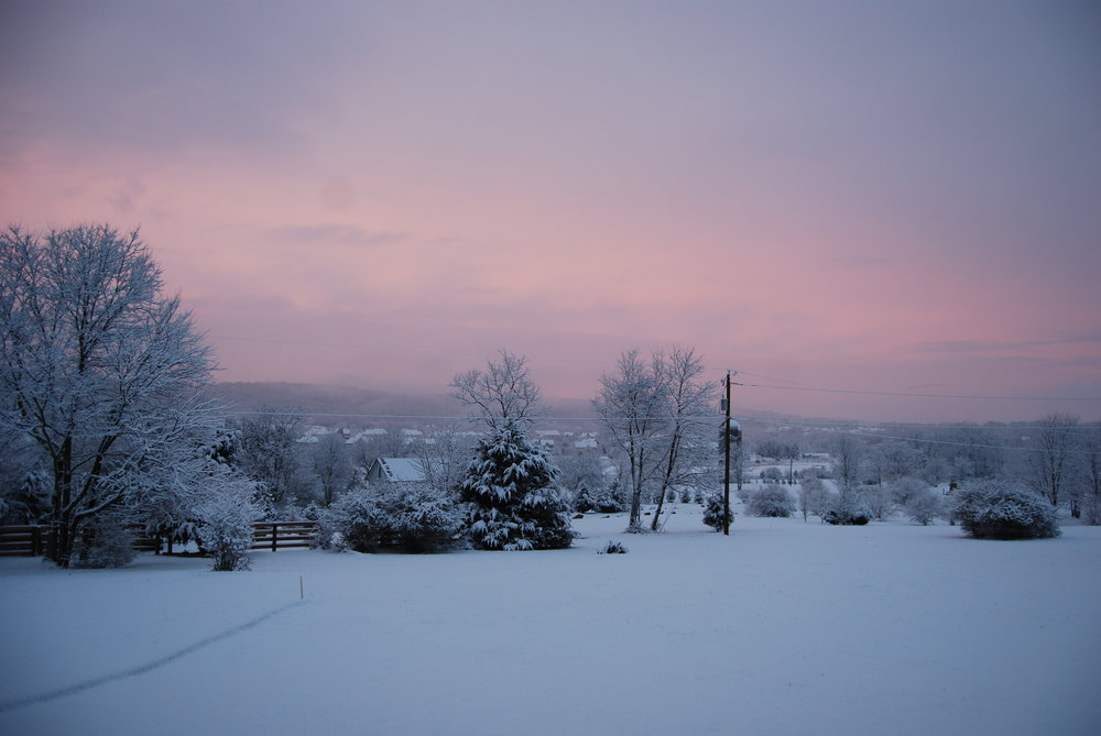 Snowy landscape with sunset wide view.JPG