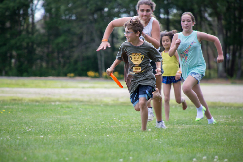 Playing capture the flag at Normandy Farms Campground in Foxborough, Mass.