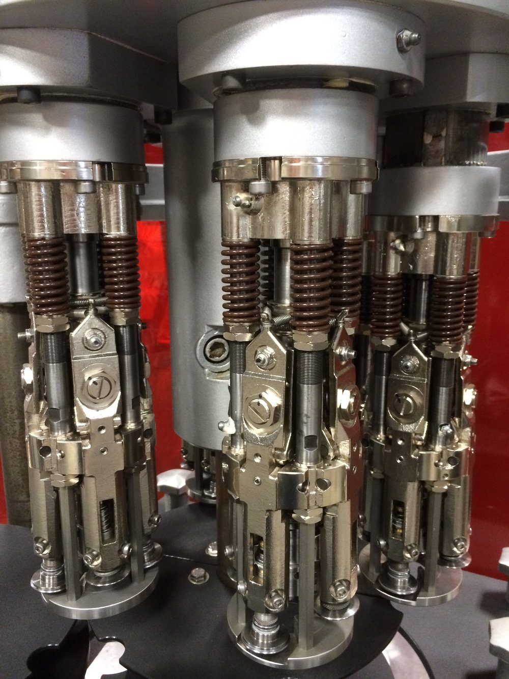 Capping Heads for Liquid Manufacturing
