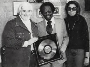 James Anthony Carmichael with Motown execs Barney Ales, Suzanne DePasse