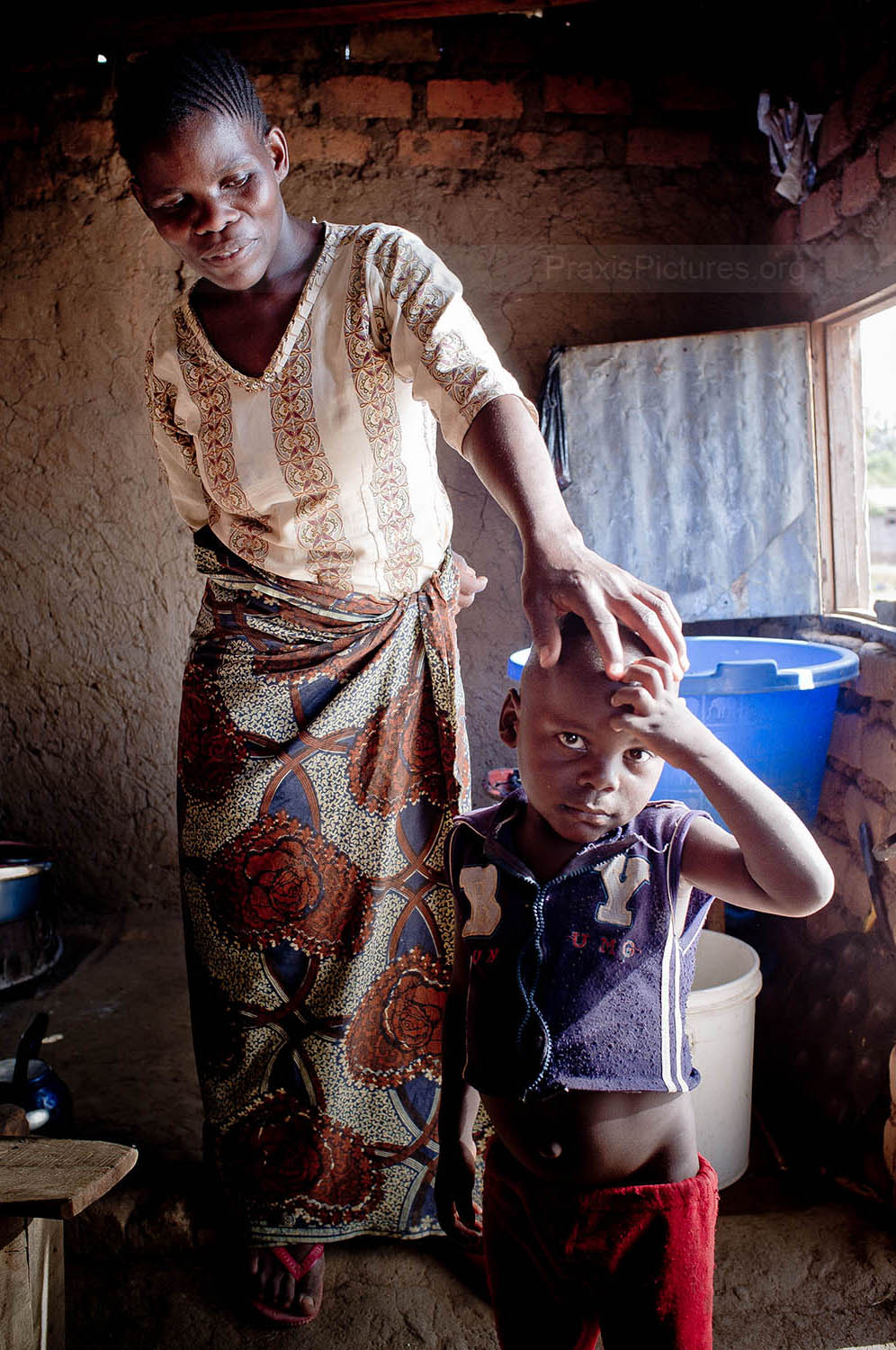 ZIANA AND CLEMENT - Ziana owns a small guest house and tea shop in Geita. Her business helps meet the basic needs of herself and her five children, and she is managing to send her children to school. Ziana is HIV+, as is her youngest son Clement (pictured with Ziana here), so without the support of her local VICOBA group, they would be in a very difficult situation.