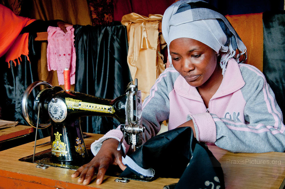 ZUENA - Zuena joined a local VICOBA group in 2007 and took out some loans to invest in her tailor shop. This investment has paid off for her as her business has grown and she now employs four of her neighbors.