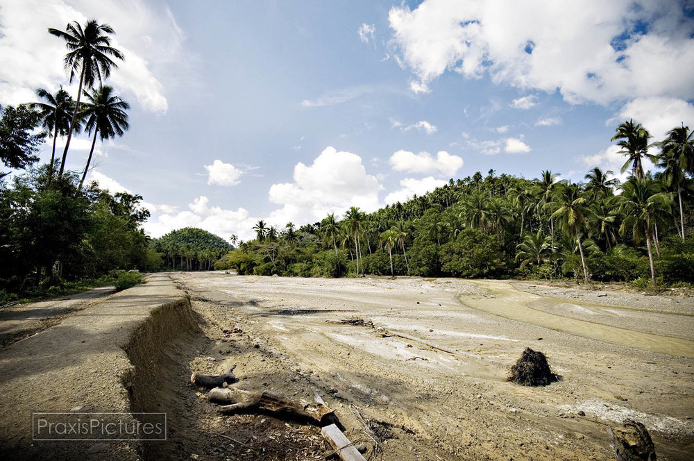 In 1993, in Marinduque, Philippines, one of the tailings dams of Placer Dome's copper mine burst sending millions of tons of mine waste raging down the Mogpog river in a flash flood that swept away homes, people and livestock. The path of destruction can still be seen, fifteen years later, all along the Mogpog River, which remains biologically dead.