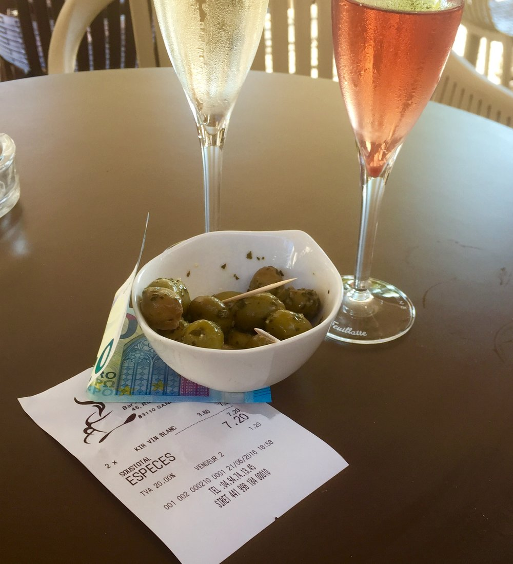 Seven euros and twenty centimes for two glasses of wine. With a view of the sea. Tax and tip included.